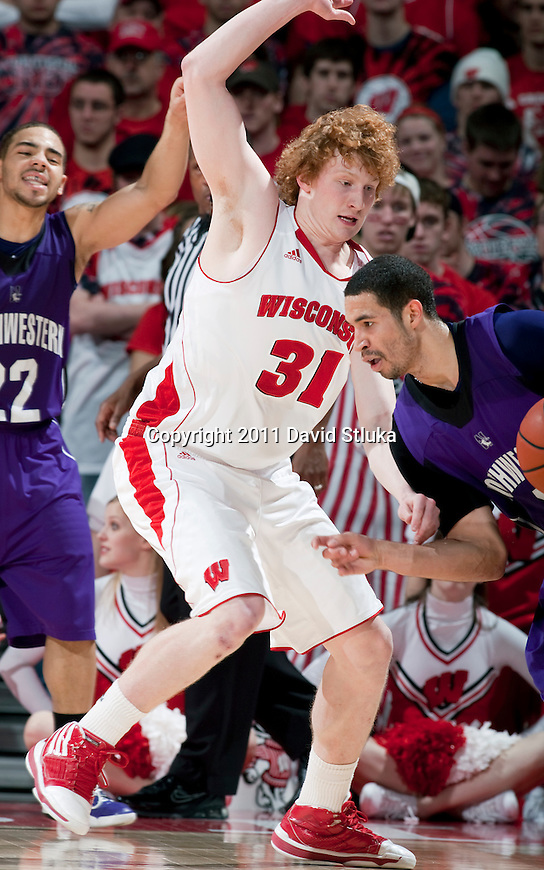 Wisconsin Badgers forward Mike Bruesewitz (31) plays defense against Northwestern Wildcats guard Drew Crawford (1) during a Big Ten Conference NCAA men's college basketball game at the Kohl Center on February 27, 2011 in Madison, Wisconsin. Wisconsin won 78-63. (Photo by David Stluka)