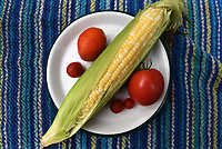 Nothing says summer like sweet corn and home-grown tomatoes.<br />(NWA Democrat-Gazette/Flip Putthoff)
