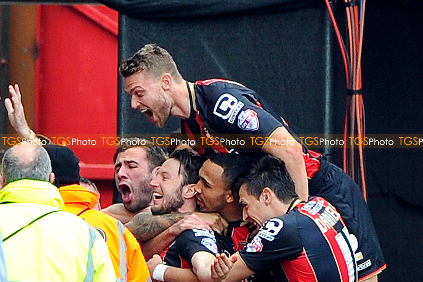 Harry Arter of AFC Bournemouth and team mates celebrate his goal in front of the Sky cameras - AFC Bournemouth vs Middlesbrough - Sky Bet Championship Football at the Goldsands Stadium, Bournemouth, Dorset - 21/03/15 - MANDATORY CREDIT: Denis Murphy/TGSPHOTO - Self billing applies where appropriate - contact@tgsphoto.co.uk - NO UNPAID USE
