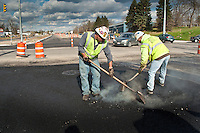 Construction workers lay asphalt on Westerville Road at Dempsey as roadway improvements near completion at the intersection. The changes are part of an improvement project at the I-270 interchange to upgrade the entrance road to Westerville, OH.