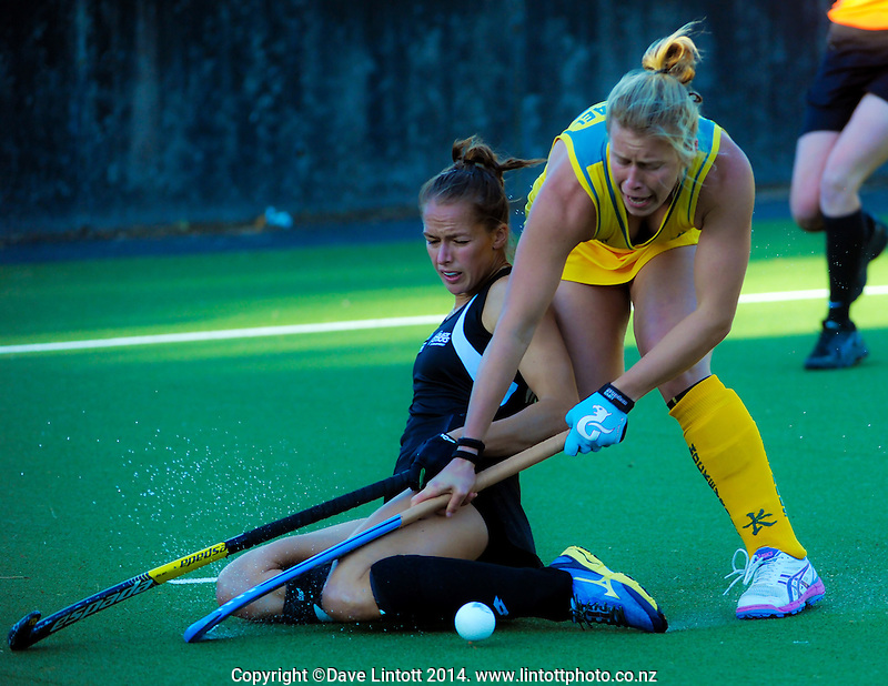 Petrea Webster tackles Mathilda Carmichael during the international women's hockey match between the NZ Black Sticks and Australia Hockeyroos at National Hockey Stadium, Wellington, New Zealand on Tuesday, 18 November 2014. Photo: Dave Lintott / lintottphoto.co.nz