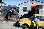 CAPE TOWN, SOUTH AFRICA - MARCH 23: Sikhumbuzo Hlahleni, age 15, a student at Cape Town City Ballet's youth company poses for pictures outside his family house on March 23, 2010 in Khayelitsha, South Africa. He trains in Cape Town every Saturday. He also trains a few days week at home in Khayelitsha, a poor township outside Cape Town. He has to change taxi three times to get to the school. (Photo by Per-Anders Pettersson).