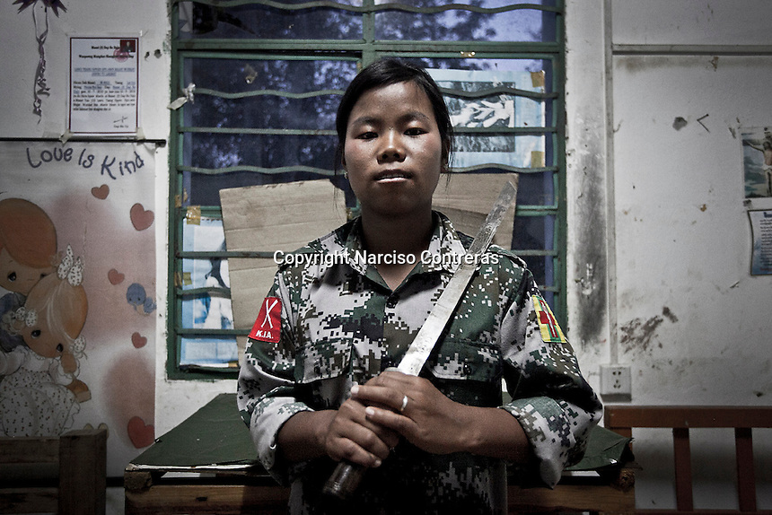 Htu Sam, who joint to the KIA three years ago, poses proudly as she holds a sword in her hands, a symbol of freedom to the Kachin people.  Since the begining of the Kachin uprising for its sovereignty women always fought by side the rebel soldiers, but officially, the female KIA was founded in 2007, since then, up to 1500 women have joint to the rebel army. The KIA is enhancing its troops number since the ceasefire was broken out by the Burmese army last June 2011.
