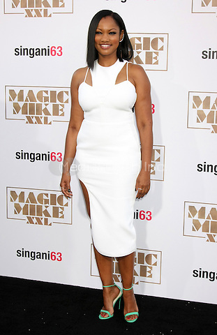 "LOS ANGELES, CA - JUNE 25: Garcelle Beauvais  at the ""Magic Mike XXL"" Premiere at the TCL Chinese Theater on June 25, 2015 in Los Angeles, California. Credit: David Edwards/MediaPunch"
