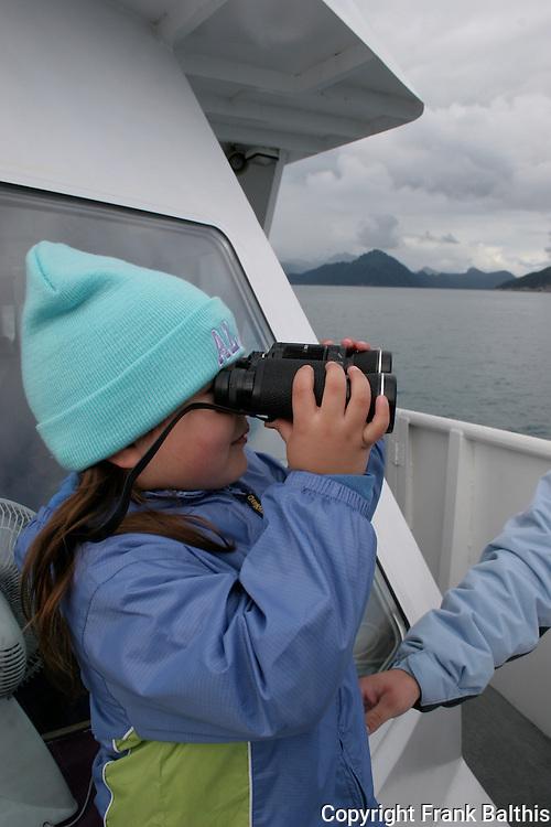 Girl watching wildlife in Kenai Fjords NP