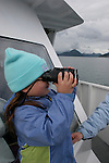 Girl watching wildlife in Kenai Fjords NP