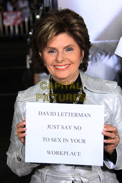 "GLORIA ALLRED.The Overature Film L.A. Premiere of ""Law Abiding Citizen"" held at The Grauman's Chinese Theater in Hollywood, California, USA. .October 6th, 2009 .half length silver jacket sign poster paper funny david letterman just say n to sex in your workplace .CAP/ADM/TC.©T. Conrad/AdMedia/Capital Pictures."