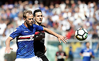 Calcio, Serie A: Genova, Stadio Luigi Ferraris, 24 settembre 2017. <br /> Sampdoria's Ivan Strinic (l) in action with Milan's Nicola Kalinic (r) during the Italian Serie A football match between Sampdoria and Milan at Genova's Luigi Ferraris stadium. September 24, 2017.<br /> UPDATE IMAGES PRESS/Isabella Bonotto
