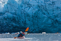 Kayakers along the tidewater face of Harriman glacier, Prince William Sound, southcentral, Alaska.