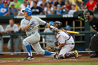 UCLA shortstop Pat Valaika (10) delivers a first inning RBI single against the Mississippi State Bulldogs in Game 1 of the 2013 Men's College World Series Final on June 24, 2013 at TD Ameritrade Park in Omaha, Nebraska. The Bruins defeated the Bulldogs 2-1, taking a 1-0 lead in the best of 3 series. (Andrew Woolley/Four Seam Images)