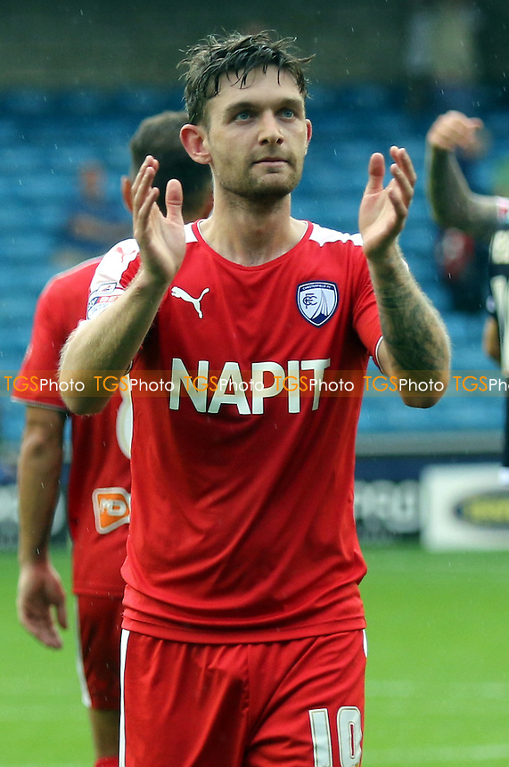 Jay O'Shea scorer of both Chesterfield goals applauds the away fans at the end of the match during Millwall vs Chesterfield, Sky Bet League 1 Football at The Den, London, England on 29/08/2015
