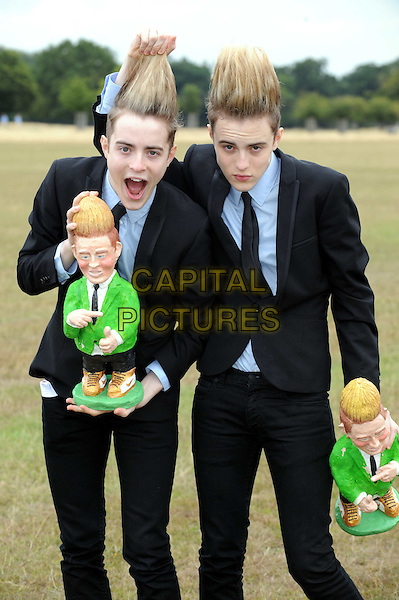 JEDWARD .John & Edward Grimes launching Rowntree's Randoms Foamy Gnome on the Roam tour, Richmond Park, London, England. .August 12th, 2010 .twins brothers family half length black suit blue shirt hair mouth open pulling grabbing hair funny gesture dolls .CAP/WIZ.© Wizard/Capital Pictures.