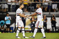 Orlando, FL - Saturday Jan. 21, 2017: São Paulo defender Rodrigo Caio (3) congratulates São Paulo defender Junior (16) for a successful penalty shot during the penalty kick shootout of the Florida Cup Championship match between São Paulo and Corinthians at Bright House Networks Stadium. The game ended 0-0 in regulation with São Paulo defeating Corinthians 4-3 on penalty kicks.