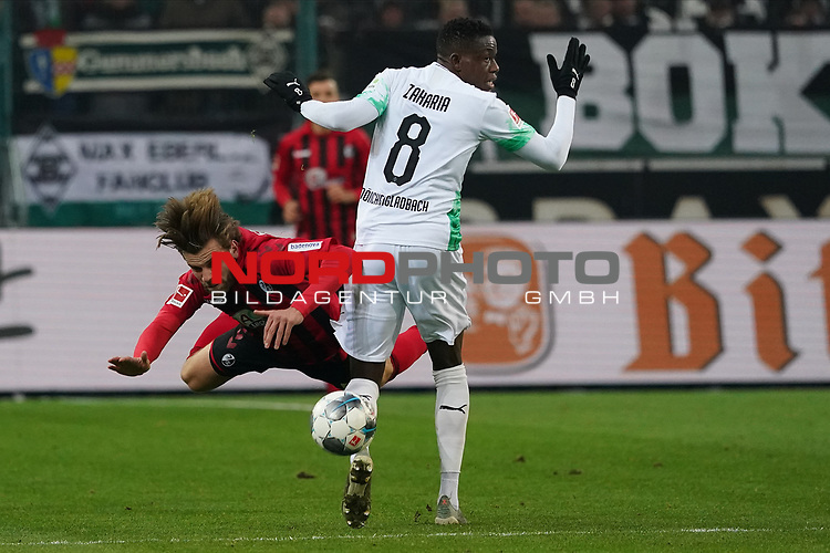 01.12.2019, Borussia Park , Moenchengladbach, GER, 1. FBL,  Borussia Moenchengladbach vs. SC Freiburg,<br />  <br /> DFL regulations prohibit any use of photographs as image sequences and/or quasi-video<br /> <br /> im Bild / picture shows: <br /> Lucas Höler / Hoeler (Freiburg #9), im Zweikampf gegen  Denis Zakaria (Gladbach #8), <br /> <br /> Foto © nordphoto / Meuter