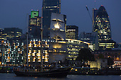 "London, UK. 4 September 2014. The 47m Barquentine 3 ""Thalassa"" sails in the Pool of London at dusk. From the Netherlands. On the eve of the Royal Greenwich Tall Ships Festival 2014, today, three Tall Ships entered the Pool of London via Tower Bridge."