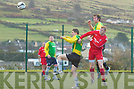 Connie O'Connor for Iveragh United in the air gets the better of Chris Farley and Jonathan Clifford for Skelliga FC, in a thrilling local derby which saw Iveragh come from 2-1 down to win 3-2.