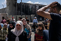 Palestinians cross the Qalandia check point of the separation barrier between Israel and the West Bank after Friday prayers at on June 10, 2016 in West Bank. <br /> Photo Daniel Berehulak for the New York Times