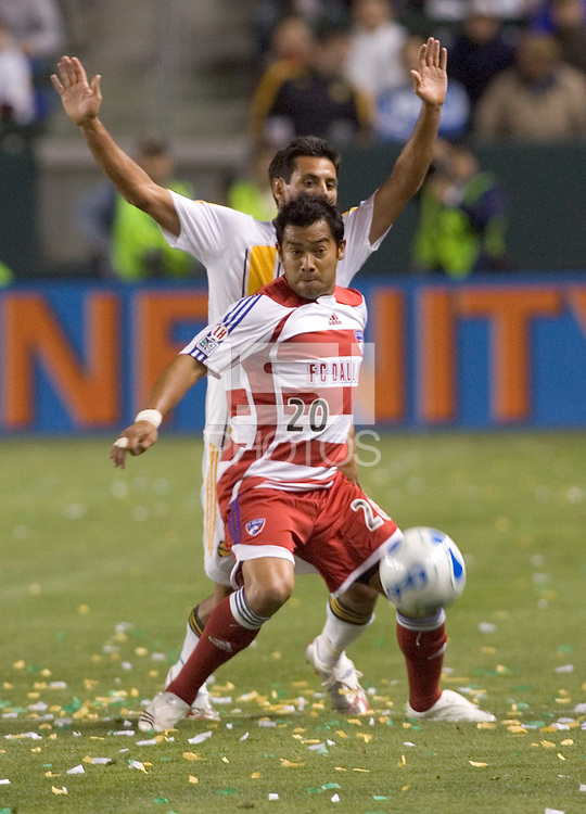 FC Dallas FWD & Captain Carlos Ruiz defends a loose ball from LA Galaxy DEF Ante Jazic during a MLS match. FC Dallas beat LA Galaxy 2-1 at the Home Depot Center in Carson, California, Thursday April 12, 2007.