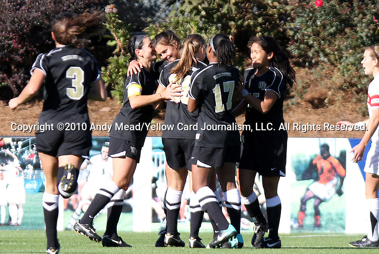 07 November 2010: Wake Forest's Katie Stengel (center) celebrates her goal with teammates. The Wake Forest University Demon Deacons defeated the University of Maryland Terrapins 3-1 on penalty kicks after the game ended in a 1-1 tie after overtime at WakeMed Stadium in Cary, North Carolina in the ACC Women's Soccer Tournament championship game.