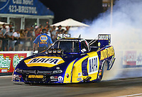 Jun 19, 2015; Bristol, TN, USA; NHRA funny car driver Ron Capps during qualifying for the Thunder Valley Nationals at Bristol Dragway. Mandatory Credit: Mark J. Rebilas-
