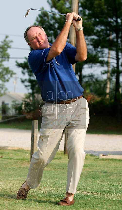 PGA Senior Tour player Allen Doyle swings at Doyle's Golf Center in LaGrange, Ga. on Wednesday, August 2, 2006. Doyle said he honed his swing at this driving range. He sold the business to a friend in 2003 after owning it for twenty years..