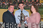CUP: Ambrose ODonovan (Senior Player of the Year) accepts the Tim OMara Memorial Cup at the Dr Crokes GAA Club Social in The Dromhall Hotel, Killarney, last Sunday night. L-r: Patrick OSullivan (Chairman), Ambrose ODonovan and Sinead OMara..