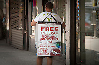 """A man wearing an English-Russian sandwich board walks in the New York City borough of Brooklyn, NY, Monday August 1, 2011. Nicknamed """"Little Odessa""""  due to many of its residents having come from Odessa, a city of Ukraine, Brighton Beach is an oceanside neighborhood in the New York City borough of Brooklyn"""