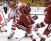 Justin Courtnall (BU - 19), Colin Moore (Harvard - 12) - The Boston University Terriers defeated the Harvard University Crimson 3-1 in the opening round of the 2012 Beanpot on Monday, February 6, 2012, at TD Garden in Boston, Massachusetts.