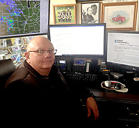 Sally Carroll/McDonald County Press<br /> McDonald County Emergency Management Director Gregg Sweeten monitors weather conditions, in addition to reviewing information from the National Weather Service.
