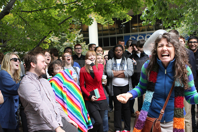 "The crowds reacts after an inflated condom hit ""Sister Cindy"" in the head in the free speech area in front of the Student Center in Lexington Ky., on Monday, Oct., 28, 2013. Photo by Judah Taylor 