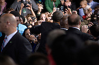 US President Barack Obama greets people after he delivered a speech at the Central High School gymnasium in Manchester, New Hampshire, on Tuesday, Nov. 22, 2011.  During the speech, Obama directly challenged Congress on the economy and spoke about the American Jobs Act, a law he stresses as necessary to ease taxes for ordinary Americans and promote job growth.  The speech was interrupted briefly by Occupy protesters who were quickly drowned out by supporters.