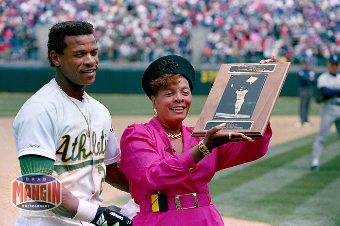 OAKLAND, CA - Rickey Henderson of the Oakland Athletics smiles and poses with his mom Bobbie Henderson after setting the all time career stolen base record by stealing base #939 during a game against the New York Yankees at the Oakland Coliseum in Oakland, California on May 1, 1991. Photo by Brad Mangin