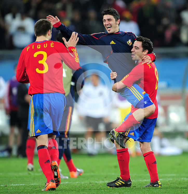 Xavi, David Villa and Gerard Pique celebrate after the 2010 FIFA World Cup South Africa Semi Final match between Germany and Spain at the Moses Mabhida  Stadium on July 7, 2010 in Durban, South Africa.