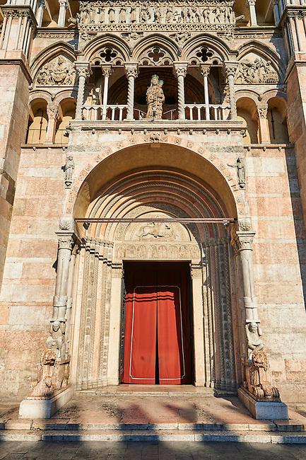 Main portal & facade of the 12th century Romanesque Ferrara Duomo, Italy