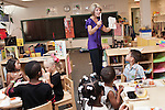 September 14, 2011. Raleigh, NC. . Kim Jackson, the head teacher for the class, shows her students how to clean up after lunch.. Project Enlightenment, a public pre-kindergarten program for at risk children, has been threatened with closure due to state wide budget cuts..