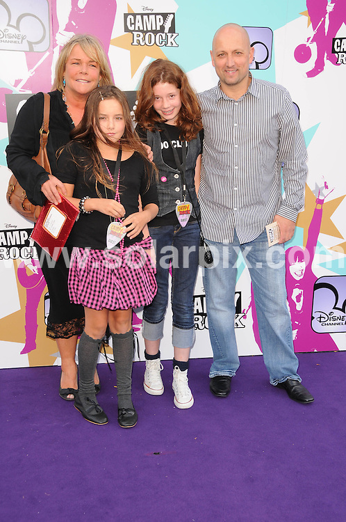 **ALL ROUND PICTURES FROM SOLARPIX.COM**.**WORLDWIDE SYNDICATION RIGHTS**.The Camp Rock premiere at the Royal festival hall in London..This pic:Linda Robson and Family..JOB REF:7283-MSR    DATE:10_09_08 .**MUST CREDIT SOLARPIX.COM OR DOUBLE FEE WILL BE CHARGED* *UNDER NO CIRCUMSTANCES IS THIS IMAGE TO BE REPRODUCED FOR ANY ONLINE EDITION WITHOUT PRIOR PERMISSION*