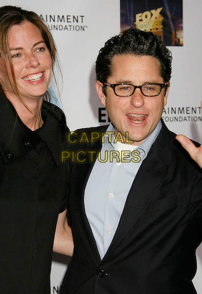 KATIE & J.J. ABRAMS.Mentor LA's Promise Gala Honoring Tom Cruise held at 20th Century Fox Studios, Century City, California, USA,.22nd March 2007..half length JJ married husband wife couplt glasses.CAP/ADM/RE.©Russ Elliot/AdMedia/Capital Pictures.