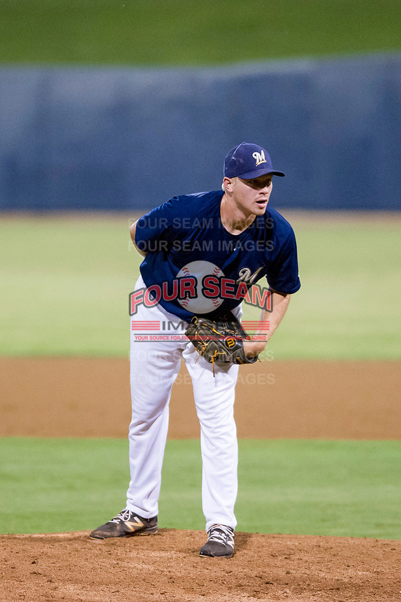 AZL Brewers relief pitcher Christian Taugner (47) looks to his catcher for the sign against the AZL Cubs on August 24, 2017 at Maryvale Baseball Park in Phoenix, Arizona. AZL Cubs defeated the AZL Brewers 9-1. (Zachary Lucy/Four Seam Images)