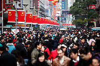 People on an extended  New Year holiday break crowd onto the main Nanjing Road shopping street in Shanghai, China. As the country's leading industrial and financial center, Shanghai has posted significantly slower growth of industrial output and foreign trade for January-November, highlighting the effects of the global financial crisis..02 Jan 2008
