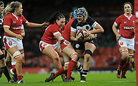 Eloise Blackwell of Barbarians is tackled by Robyn Lock of Wales<br /> <br /> Photographer Ian Cook/CameraSport<br /> <br /> 2019 Autumn Internationals - Wales Women v Barbarians Women - Saturday 30th November 2019 - Principality Stadium - Cardifff<br /> <br /> World Copyright © 2019 CameraSport. All rights reserved. 43 Linden Ave. Countesthorpe. Leicester. England. LE8 5PG - Tel: +44 (0) 116 277 4147 - admin@camerasport.com - www.camerasport.com
