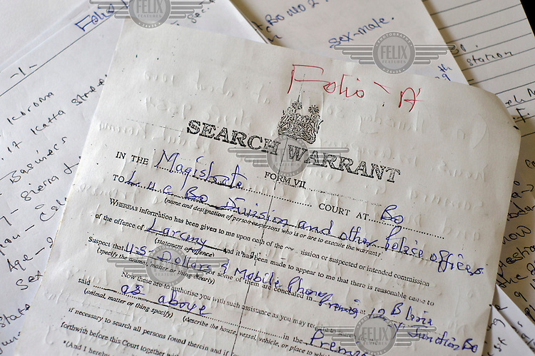 A search warrant served in a case against a man accused of theft, as well as handwritten records of statements that make up the case file at the Criminal Investigation Department (CID) office at Bo central police station.