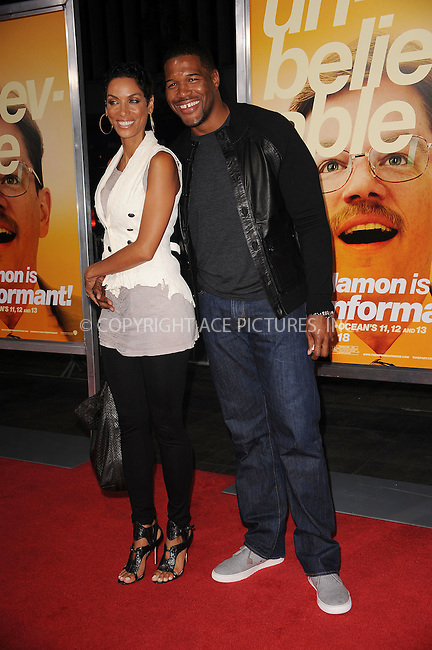 WWW.ACEPIXS.COM . . . . . ....September 15 2009, New York City....Nicole Murphy and Michael Strahan arriving at the 'The Informant' benefit screening at the Ziegfeld Theatre on September 15, 2009 in New York City.....Please byline: KRISTIN CALLAHAN - ACEPIXS.COM.. . . . . . ..Ace Pictures, Inc:  ..tel: (212) 243 8787 or (646) 769 0430..e-mail: info@acepixs.com..web: http://www.acepixs.com