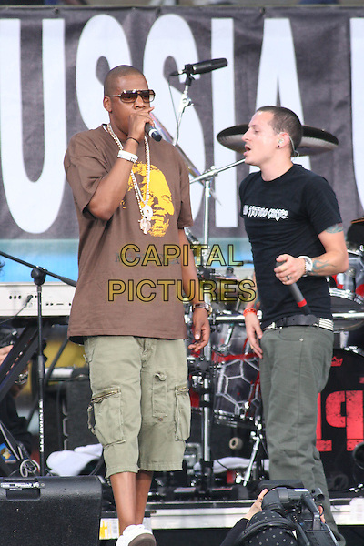 LINKIN PARK (CHESTER BENNINGTON) & JAY-Z.Perfom at Live 8 Philadelphia - A concert to raise awareness for an end to extreme poverty in Africa (Make Poverty History) ahead of the G8 Summit taking place later this week. .Philadelphia Museum of Art, Philadelphia, .Pennsylvania, USA, July 2nd 2005..full length gig makepovertyhistory live8 aid sunglasses brown t-shirt t shirt shorts jay Z white rubber bracelet wrist band Nelson Mandela face logo.Ref: IW.www.capitalpictures.com.sales@capitalpictures.com.©Ian Wilson/Capital Pictures.