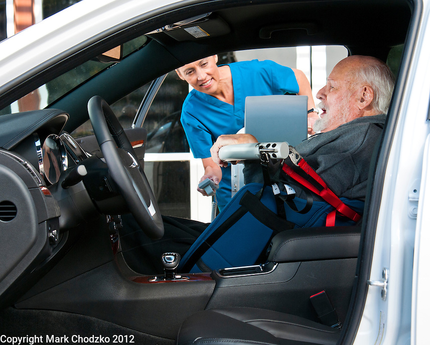 Nurse secures patient in car using KCI medical device