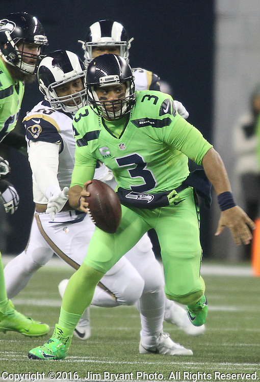 Seattle Seahawks quarterback Russell Wilson (3) scrambles for a first down at CenturyLink Field in Seattle, Washington on December 15, 2016. The Seahawks beat the Rams 24-3.  ©2016. Jim Bryant Photo. All Rights Reserved