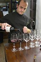 pouring wine for tasting  Restaurant La Garrocha Valladolid spain castile and leon