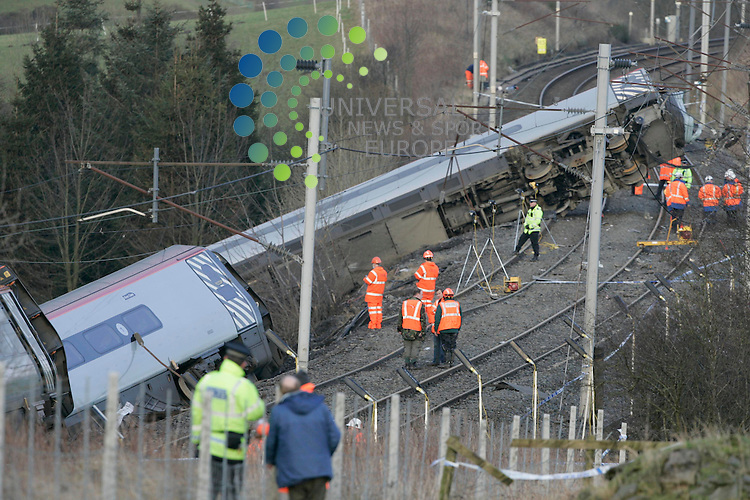 Rail Inspectors looking at the points near the wreckage of the high speed Pedolino train which derailed on the West Line at Grayrigg in Cumbria. An elderly woman died and five other passengers were seriously hurt when the 17.15 from London Euston left the track and several carriages tumbled down an embankment around 20.15GMT. It is thought faulty points may have caused the train to derail..Maurice McDonald Universal News/Photo..
