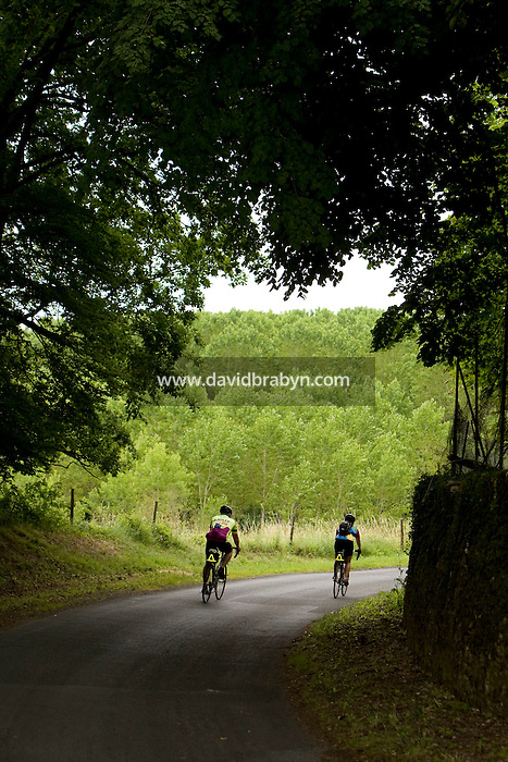 Participants in a Backroads cycle tour of the Loire Valley, ride towards Athee-sur-Cher, France, 25 June 2008.
