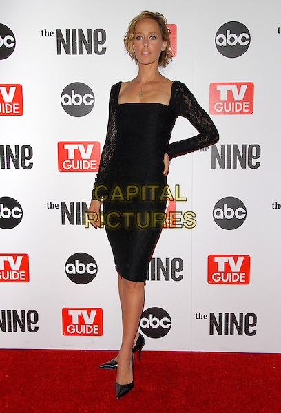 KIM RAVER.The ABC, TV Guide and Warner Bros. Television Presentation of The Nine Screening held at L.A. Center Studios in Los Angeles, California, USA..September 18th, 2006.Ref: DVS.full length black dress lace sleeves hand on hip.www.capitalpictures.com.sales@capitalpictures.com.©Debbie VanStory/Capital Pictures