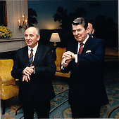 United States President Ronald Reagan and General Secretary of the Communist Party of the Soviet Union Mikhail Sergeyevich Gorbachev check the time in the Diplomatic Reception Room of the White House in Washington, D.C. on Wednesday, December 9, 1987.  The President referred to this situation during an interview with columnists in the afternoon..Mandatory Credit: Bill Fitz-Patrick - White House via CNP